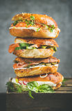 Heap of Bagels with salmon, eggs, vegetables, capers and cream-cheese Stock Image