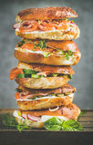 Heap of Bagels with salmon, eggs, vegetables, capers, cream-cheese, herbs Stock Photos
