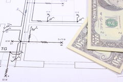 Heap of banknotes on construction drawing of house Stock Photos
