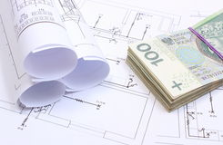 Heap of banknotes and electrical diagrams on construction drawing of house Royalty Free Stock Photography