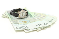 Heap of banknotes and wristwatch. White background Royalty Free Stock Photos