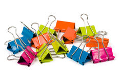 Heap of binder clips. Isolated on white Stock Image
