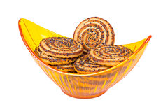 Heap of biscuits in a halfmoonlike yellow transpar Royalty Free Stock Photo