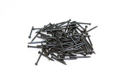 Heap of Black Concrete nails. On white background Stock Photography
