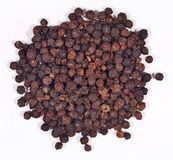 Heap of black pepper on a white Stock Image