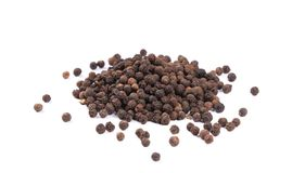 Heap of black spicy peppercorn. Royalty Free Stock Image