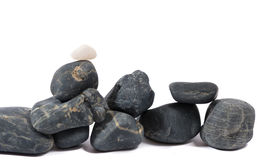Heap of black stones isolated on white Stock Photo