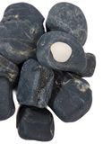 Heap of black stones isolated Stock Photos