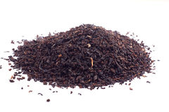 Heap of black tea. Isolated over white background Stock Images