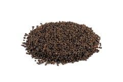 Heap of black tea. Black tea from Assam region of India isolated on white Stock Photo