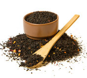 Heap of black tea. And bowl on white background Stock Images