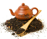 Heap of black tea. And cup on white background Stock Photography
