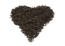 Heap of black tea in form heart Stock Photography