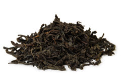 Heap of black Tea. Isolated on white background Stock Images