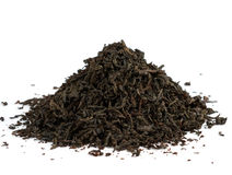 Heap of black tea. Heap of large leaf black tea isolated on white background Royalty Free Stock Photography