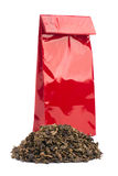 Heap of black tea and tea package Stock Image