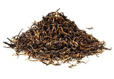 Heap of black tea on white background. Close up. High resolution Stock Images