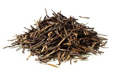 Heap of black tea on white background. Close up. High resolution stock photo