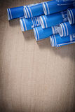 Heap of blue blueprint rolls on wooden board construction concep Stock Photos