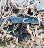 Heap of blue jeans denim torn tear thread Royalty Free Stock Photo