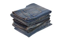 Heap of blue jeans Stock Photos