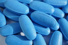 Heap of blue oval pills as a symbol of medicine, healing and pharmacy. Heap of blue oval pills as a symbol of medicine, healing and pharmacy Stock Images