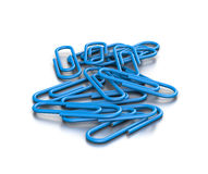 Heap of Blue Paperclips. Heap of Untidy Blue Paperclips on White Background 3D Illustration Royalty Free Stock Photos