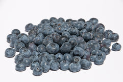 A heap of blueberries. (lat. Vaccinium Myrtillus) isolated on white background stock images