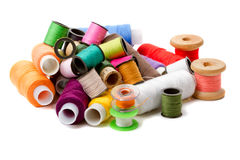 Heap bobbins of sewing threads Stock Images