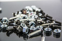 Heap of bolts, screws and nuts on neutral background Royalty Free Stock Image