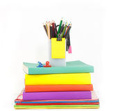Heap of book and stationery against white background Stock Photography