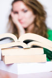 Heap of Books. With girl background Royalty Free Stock Photography