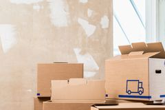 Heap of boxes in the interior of a residential room ready for renovation Royalty Free Stock Images