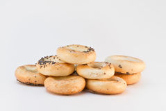 Heap of bread rings. Heap of several bread rings with poppy over gray background Royalty Free Stock Photo