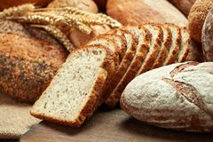 Heap of bread. Heap of various kind of bread on wooden background royalty free stock image