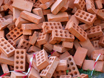 Heap bricks. A large pile of red bricks for the construction in a full disorder stock images