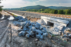 Heap of bricks and stones lying beside a newly built railway track Royalty Free Stock Photography