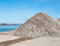 Heap of broken brick and concrete on the riverbank Royalty Free Stock Photography