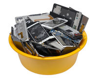 Heap of the  broken  cellular telephotons. In the orange plastic container. Mass production devices are prepared for industrial utilization. Isolated with patch Royalty Free Stock Image