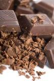 Heap of broken chocolate isolated Stock Image