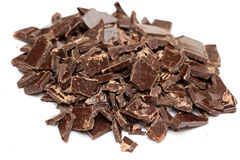 Heap of broken chocolate. On white background. Close-up Royalty Free Stock Image