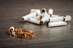 Heap of broken cigarettes and tobacco Stock Photography