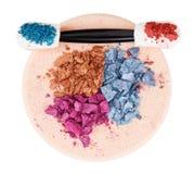 Heap of broken multicolor eyeshadow over sponge Stock Photo
