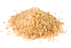 Heap of brown cane sugar isolated on white. Macro lens shot Stock Photos