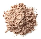 Heap of chocolate protein powder. Heap of brown chocolate protein powder isolated on white background. Top view royalty free stock photography