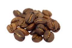 Heap of brown coffee beans isolated on white background Stock Photography
