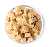 Heap of brown sugar in bowl,  Stock Images