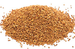 Heap of buckweat grains on white background. Heap of buckwheat grains on white background, close up view stock photo