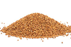 Heap of buckweat grains on white background. Close up view stock image