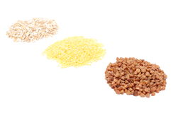 Heap of buckwheat, millet and barley groats. White background Royalty Free Stock Photo